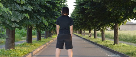 treelined: asphalted road with tree-lined avenue and person shoulders