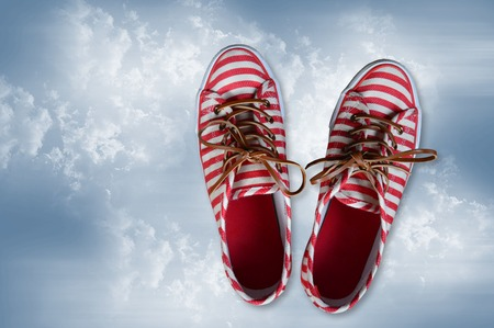 without clothes: pair of sneakers made of canvas on cloudy sky Stock Photo