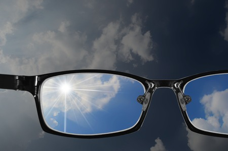 visually: glasses with blue sky and part of bad sky