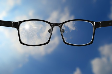 shortsighted: glasses with blue sky and part of very blurry sky