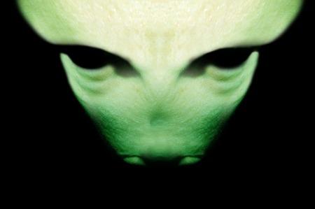 parallel world: green alien on a black background