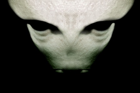 parallel world: gray alien on a black background