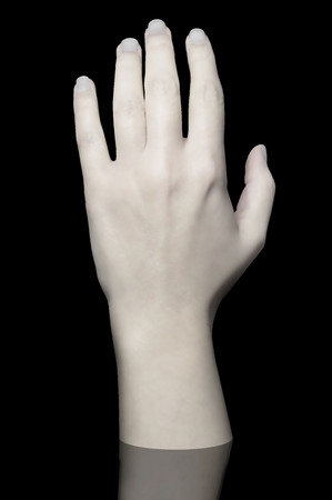 white cadaver hand on black background Stock Photo
