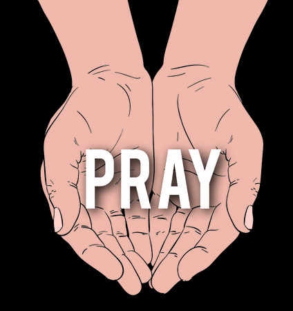 hands with message: PRAY, on a black background Stock Photo