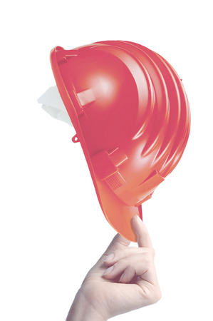 hand holding construction helmet on white background Stock Photo