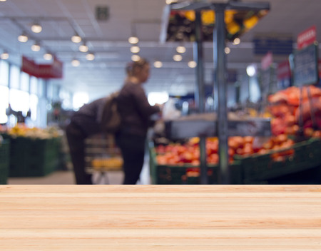 second floor: blurred fruit shop with buyers and wooden shelf in the foreground