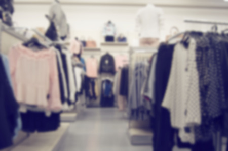 second floor: blurred background of clothing store with mannequins Stock Photo