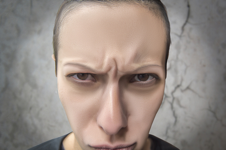 Woman making whims with angry look on blurry background