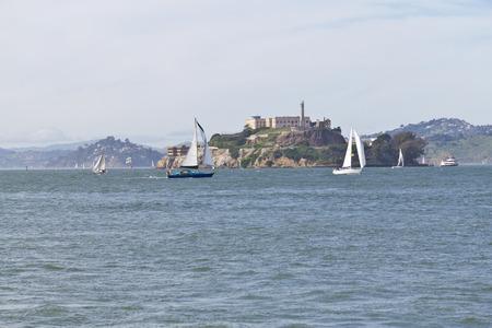 navigating: Sail boats navigating in front of Alcatraz Island