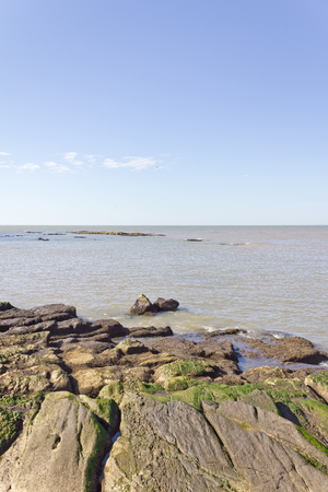 montevideo: La Plata river at Montevideo with stones and blue sky.