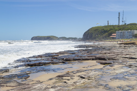 Sunny day with waves and blue sky at Torres, Rio Grande do Sul. Stock Photo
