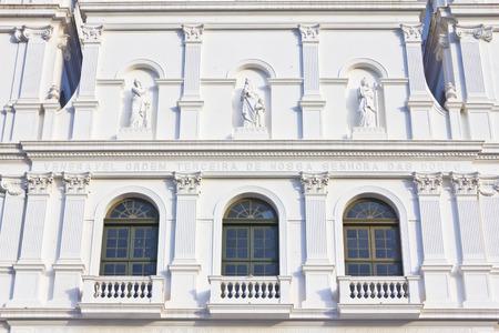 quaint: Details in the front of Nossa Senhora das Dores catholic church with blue sky