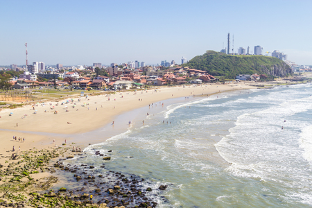 cal: Sunny day with waves and blue sky at Cal beach, Torres, Rio Grande do Sul.