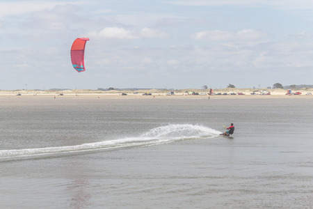 kitesurf: Man in his kitesurf in side of Cassino breakwaters (molhes)