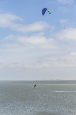 kitesurf: Woman flying in his kitesurf in side of Cassino breakwaters (molhes) Stock Photo