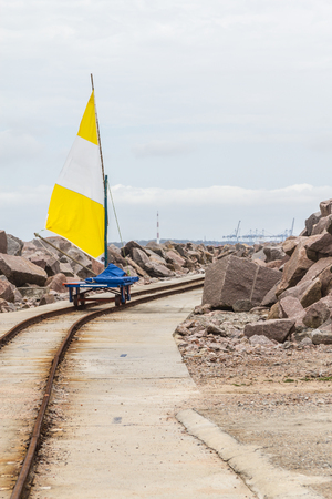 do: vagoneta moving over the rail at breakwater with rio grande port in background