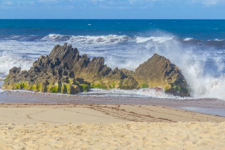 Waves craching into  Rocks in Pessegueiro beach in Porto Covo, Alentejo, Portugal