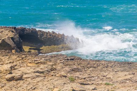 Waves craching into rocks in Vila Nova das Milfontes, Alentejo, Portugal