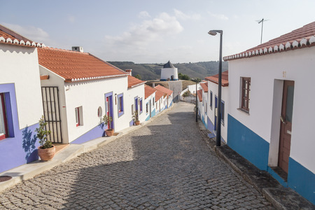 Houses and windmill in Odeceixe village, Alentejo, Portugal