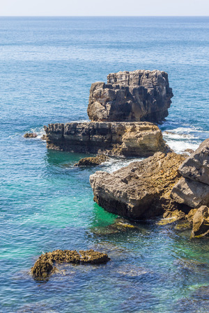 Cliff and ocean in Cascais, Portugal