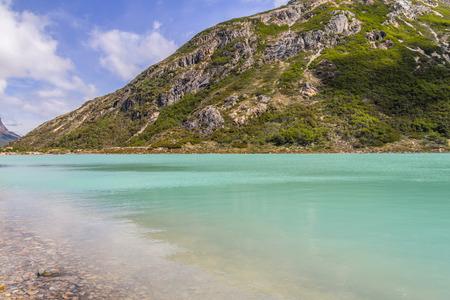 Laguna Esmeralda trail with  mountains and vegetation, Ushuaia, Patagonia, Argentina Banco de Imagens - 95777350