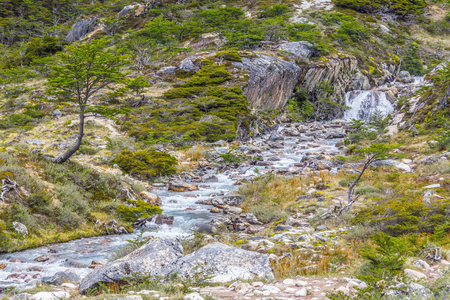 Laguna Esmeralda trail with forest, stream and waterfall, Ushuaia, Patagonia, Argentina Banco de Imagens - 95862157