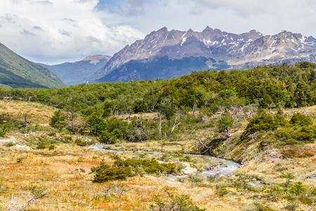 Laguna Esmeralda trail with forest, stream and mountains, Ushuaia, Patagonia, Argentina