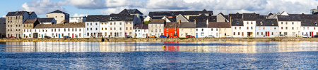 Panorama of Galway city with village houses and Corrib river, Ireland