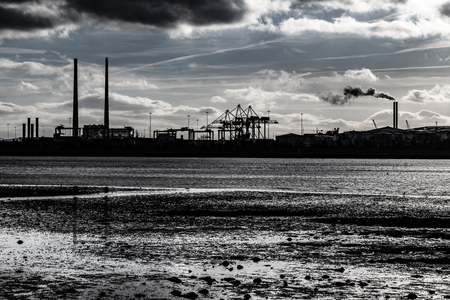 Dublin port Silhouette with clouds and river reflection, Ireland Stock Photo