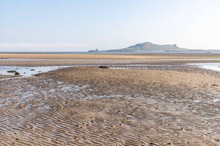 Low tide  in Burrow beach with Irelands Eyes island in background, Sutton, Dublin, Ireland 写真素材
