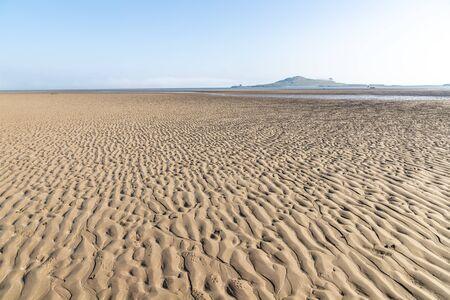 Low tide  in Burrow beach with Ireland's Eyes island in background, Sutton, Dublin, Ireland