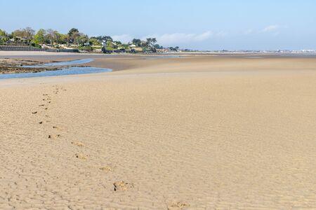 Houses and sand  in Burrow beach, Sutton, Dublin, Ireland