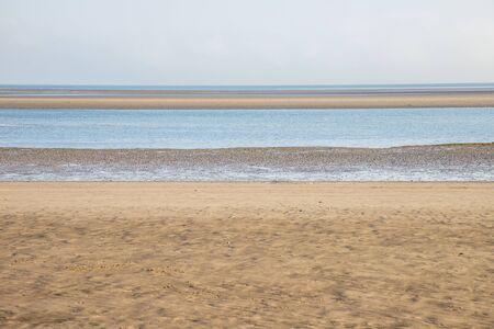 Low tide in Burrow beach, Sutton, Dublin, Ireland 写真素材