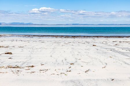 Beach with sand and seaweeds in Inishmore, Aran Islands, Ireland