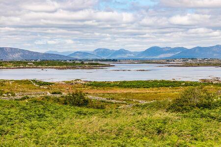 Farm field, Bay and mountains in Carraroe, Conemara, Galway, Ireland