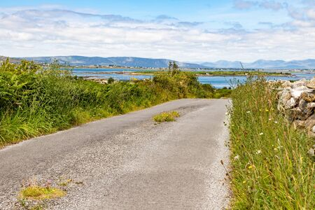 Road with bay and mountains in Carraroe, Conemara, Galway, Ireland