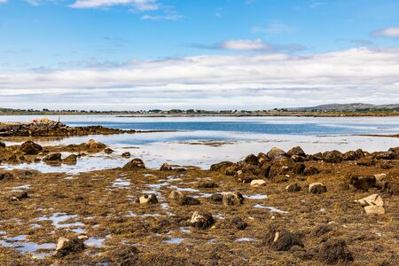 Bay with low tide and mountains in Carraroe, Conemara, Galway, Ireland