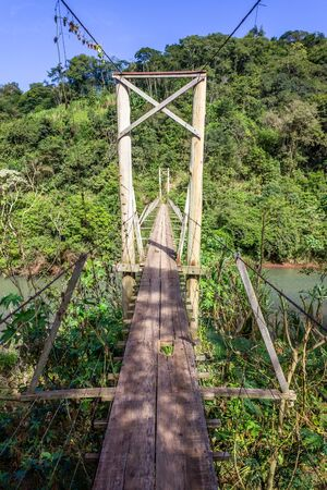 Iron and wood small bridge over a river, Santa Cruz do Sul, Rio Grande do Sul, Brazil Banco de Imagens
