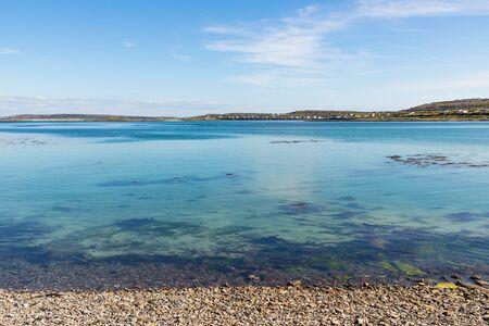 Stones and seaweeds in the beach in Inishmore, Aran Islands, Ireland