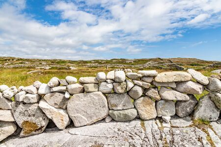 Stone wall and farm field in Carraroe, Conemara, Galway, Ireland