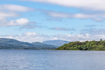 Lough Corrib with forest and Conerama mountains in background, Oughterard, Ireland Banco de Imagens