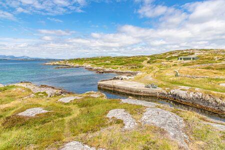 Pier with rocks and vegetation in Carraroe, Conemara, Galway, Ireland