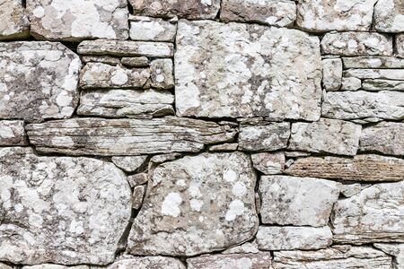 Rock stone gray and white ruins wall background