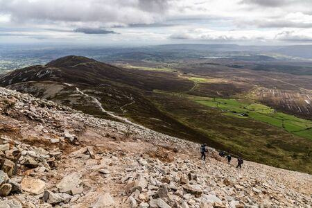 Hiking with Trail, Rocks and vegetation at Croagh Patrick mountain, Westport, Ireland
