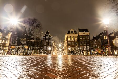 Night lights of building and biclycles in Amsterdan, Nederlands Stock Photo