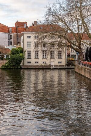 Buildings and tree around channels in Bruges, Belgium Stock Photo