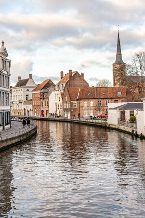 Buildings with reflection around channels in Bruges, Belgium