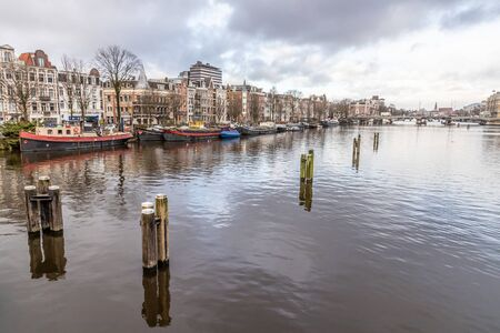 Boats, building and channels in Amsterdan, Nederlands