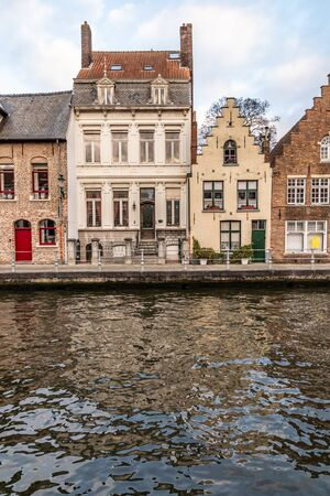 Buildings with reflection around channels in Bruges, Belgium Stock Photo