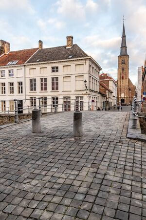 Buildings, street and church tower in Bruges, Belgium